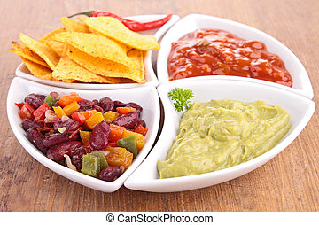 assortment of dips and tortillas chips