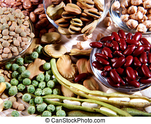 Assortment of dried legumes including varieties of beans,...