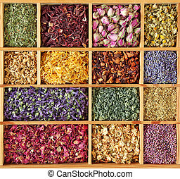 Assortment of dried tea in wooden box