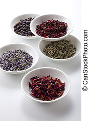 Assortment of dry medicinal herbs in bowls