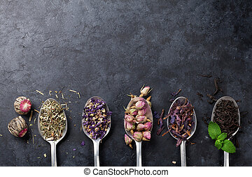 Assortment of dry tea in spoons