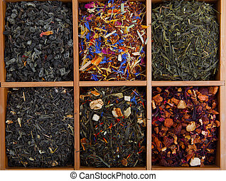 assortment of dry tea in wooden box