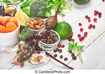 Assortment of foods for healthy liver on white wooden background.