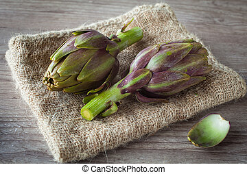 artichokes - Assortment of fresh artichokes on wooden...