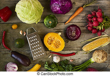 Assortment of fresh fruits and vegetables on wooden background, top view