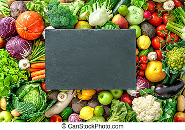 Assortment of fresh fruits and vegetables with the copy space for your text