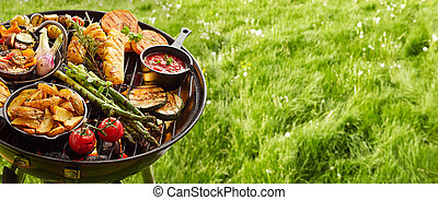 Assortment of fresh healthy vegetables on a BBQ