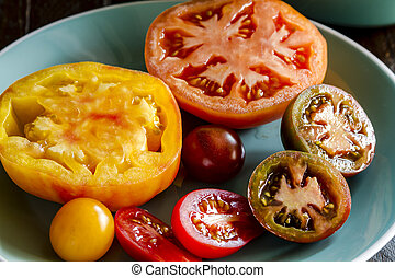 Assortment of Fresh Heirloom Tomatoes - Varieties of sliced...