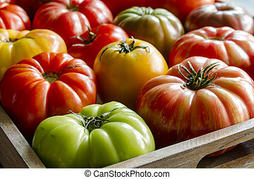 Assortment of Fresh Heirloom Tomatoes - Wooden box filled...