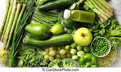 Assortment of fresh organic antioxidants. Green fruits and...