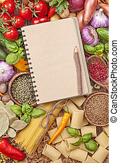 Assortment of fresh vegetables and blank recipe book