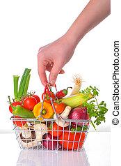 fresh vegetables in metal basket