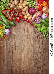 Assortment of fresh vegetables on a wooden background