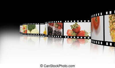 Assortment of Fruit and veg on a film reel - A collage of...