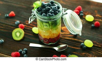 Assortment of fruits in jar - Closeup glass jar with sliced...