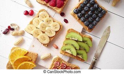 Assortment of healthy fresh breakfast toasts. Bread slices...