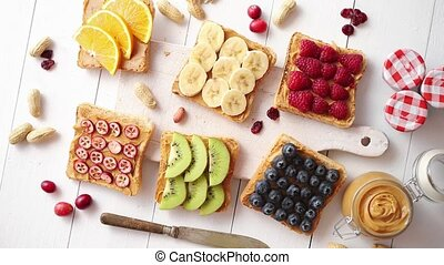 Assortment of healthy fresh breakfast toasts. Bread slices ...