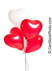 Assortment of heart balloons on white