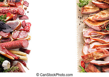 assortment of meat products including sausage ham bacon ...