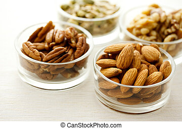Assortment of nuts in glass containers