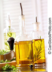 Assortment of olive oils on stainless steel counter top