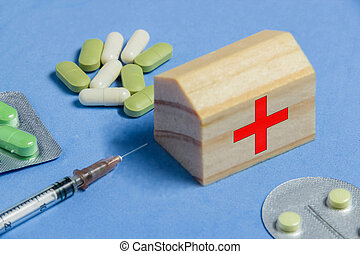 Assortment of Pills, Tablets and Capsules, Syringe on Blue Table. Medicine Ambulance Creative Concept.