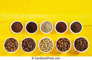 Assortment of roasted and raw coffee in bowls