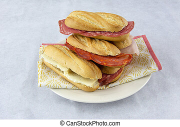 Assortment of sandwiches with sausage, cheese and ham