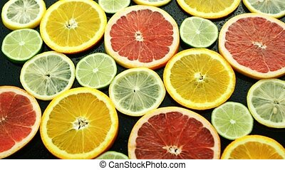 Assortment of sliced citruses - From above assortment of...
