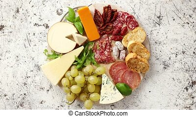 Assortment of spanish tapas or italian antipasti with meat,...