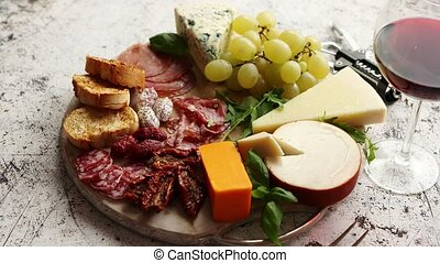 Assortment of spanish tapas or italian antipasti with meat, ...