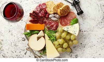 Assortment of spanish tapas or italian antipasti with meat,...