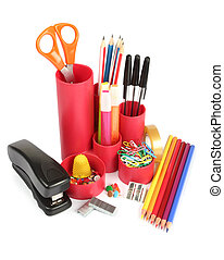Assortment of office stationery on a white background
