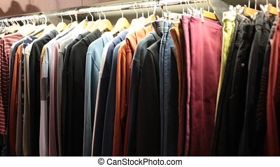 Different assortment of fashionable stylish beautiful clothing in the modern boutique