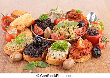 assortment of toast and tapenade
