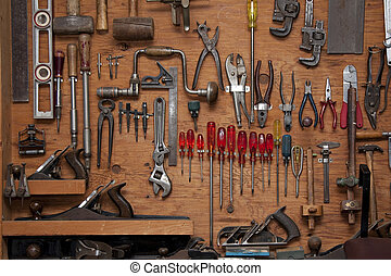 assortment of tools - assortment of DIY tools hanging in a...