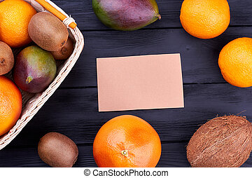 Assortment of tropical fruits and blank card. Variety of...