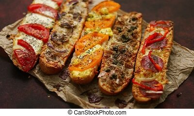 Assortment of various toppings baked sandwiches. With melted...