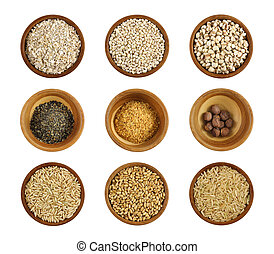 Assortment of wholesome ingredient in a wooden bowl - Oats, ...