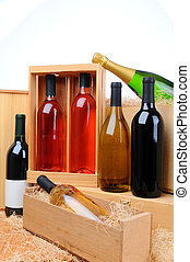 Assortment of wine bottles on crates - An assortment of wine...