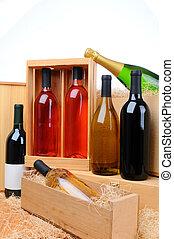An assortment of wine bottles on wooden crates. Vertical format.