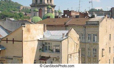 Assumption church tower, Lviv. Blue sky and religious...