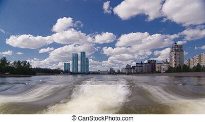 Astana, Kazakhstan. View from Pleasure boat on the river Ishim timelapse hyperlapse drivelapse in Astana.