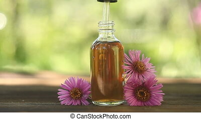 aster essential oil in  beautiful bottle on table
