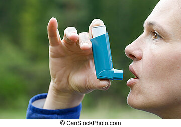 Asthma patient inhaling medication