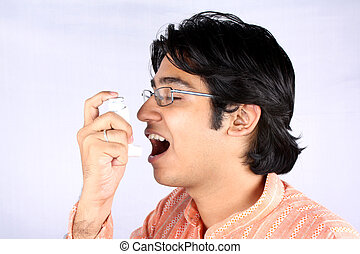 Asthmatic - A portrait of an asthmatic young Indian guy...