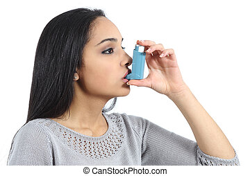 Asthmatic arab woman breathing from a inhaler isolated on a...
