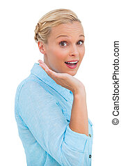 Astonished blonde woman looking at camera