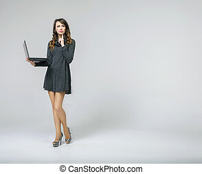 Astonished brunette lady with notebook