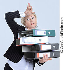 astonished business woman with stack of documents